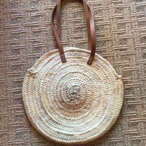 Woven round shoulder bag